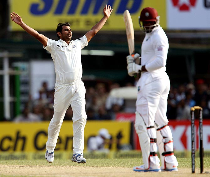 Mohammed Shami celebrates getting the wicket of Sheldon Cottrell