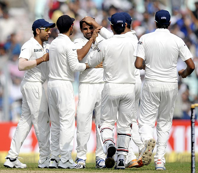 Mohammed Shami (centre) celebrates with team mates after getting the wicket of Kieran Powell