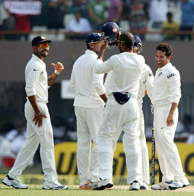 PHOTOS: Tendulkar gets a wicket in his 199th Test!