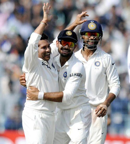 Sachin Tendulkar celebrates after picking up a wicket