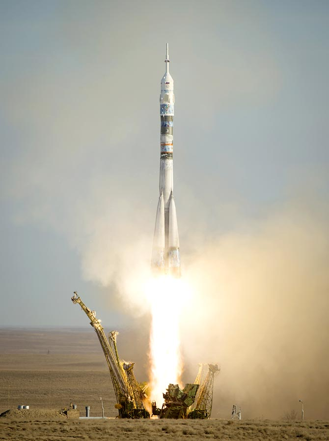 In this handout photo provided by NASA, The Soyuz TMA-11M rocket is launched with Expedition 38 Soyuz Commander Mikhail Tyurin of Roscosmos, Flight Engineer Rick Mastracchio of NASA and Flight Engineer