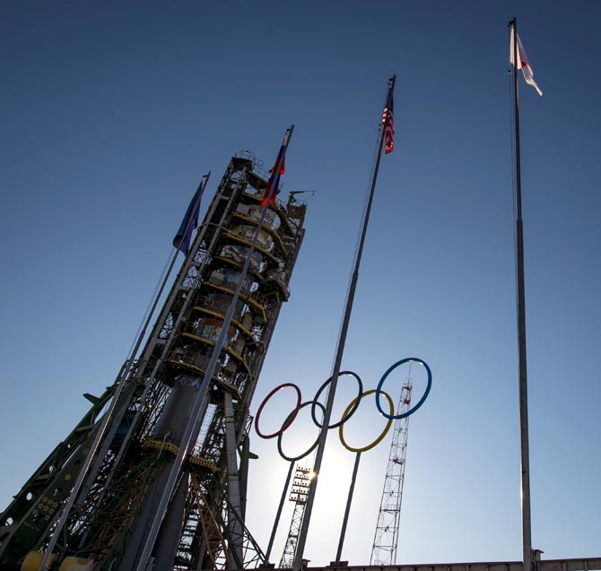 Olympic rings are seen at the Soyuz launch pad shortly after the Soyuz TMA-11M rocket was erected into position at the Baikonur Cosmodrome in Baikonur, Kazakhstan
