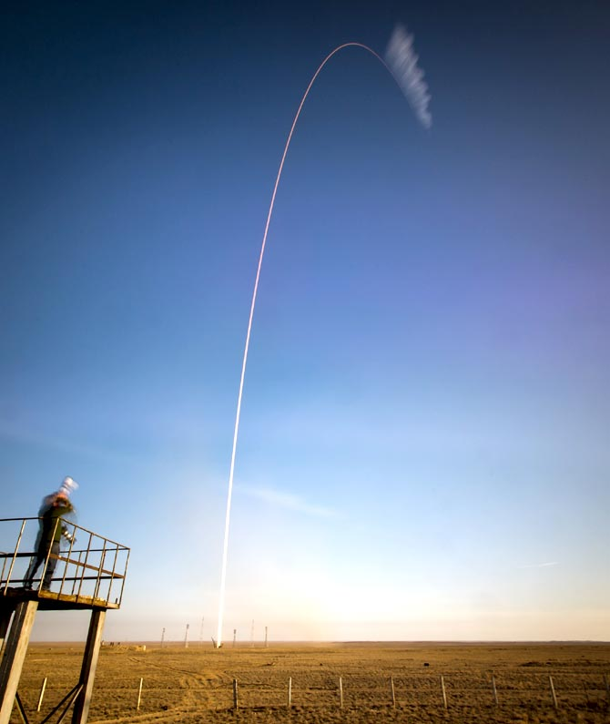 In this handout photo provided by NASA, The Soyuz TMA-11M rocket, in the two minute exposure during its launch