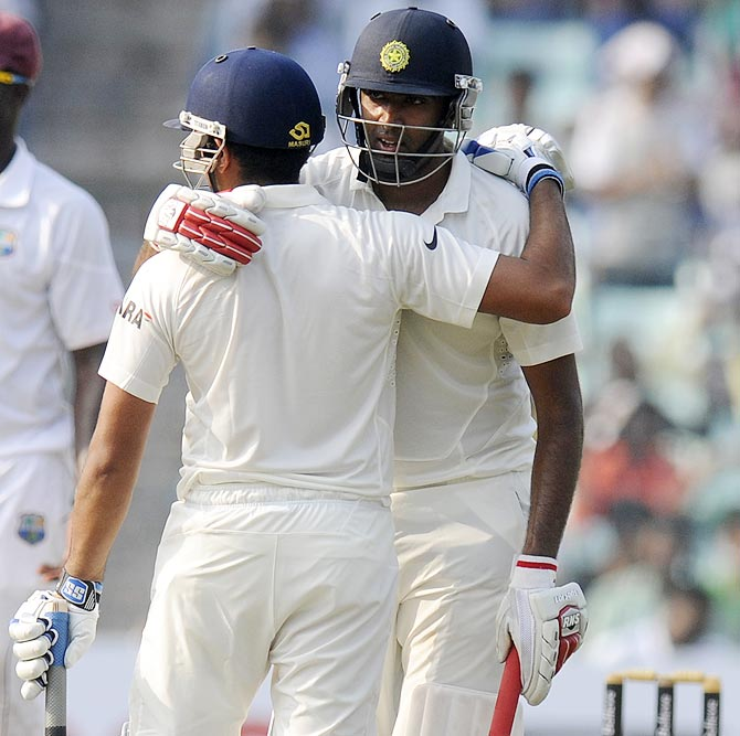 R Ashwin (right) hugs Rohit Sharma