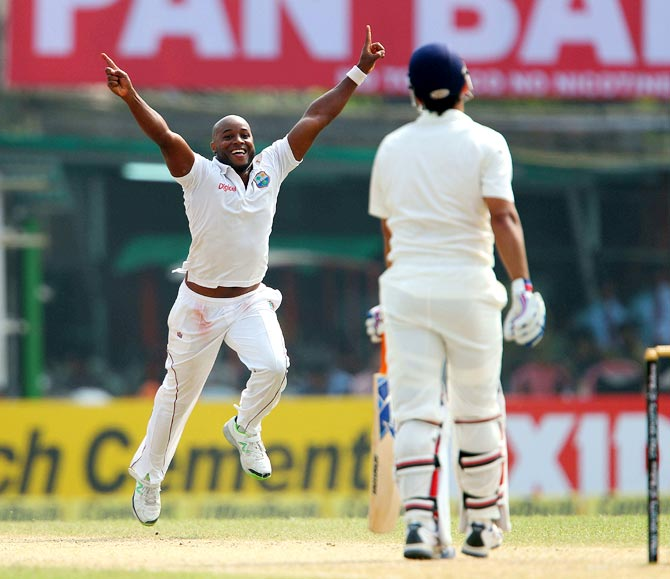 Tino Best celebrates after getting the wicket of Mahendra Singh Dhoni