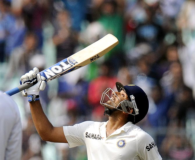 Rohit Sharma celebrates on completing his half century