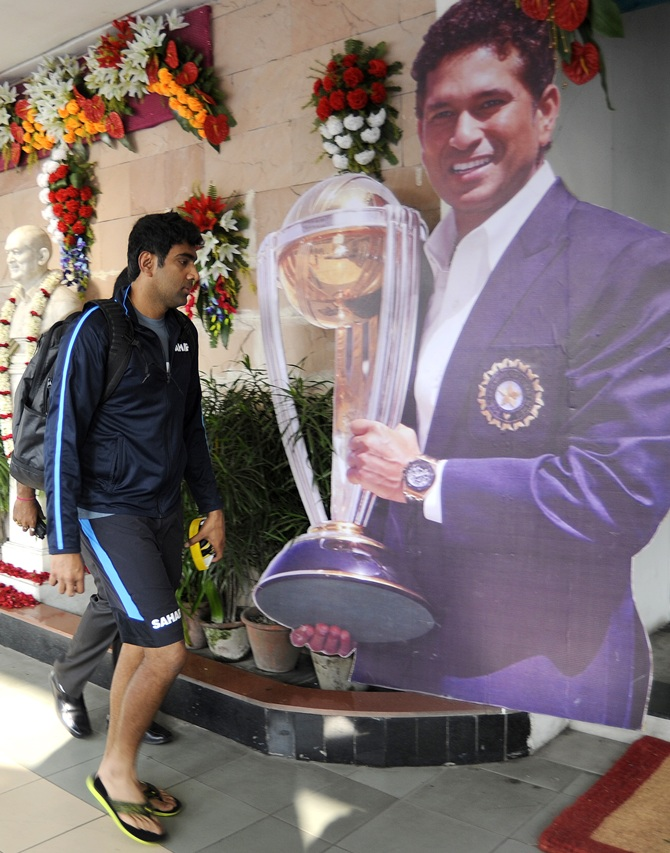 R Ashwin walks past Sachin Tendulkar's poster