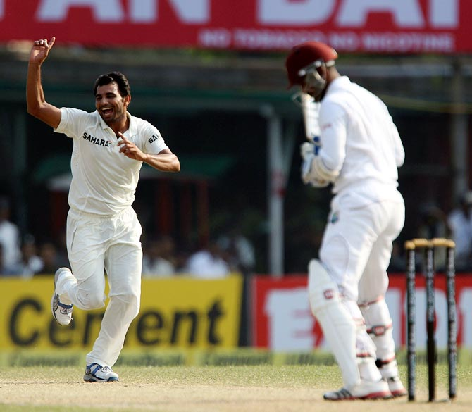 Mohammad Shami celebrates as Marlon Samuels is given out leg before wicket