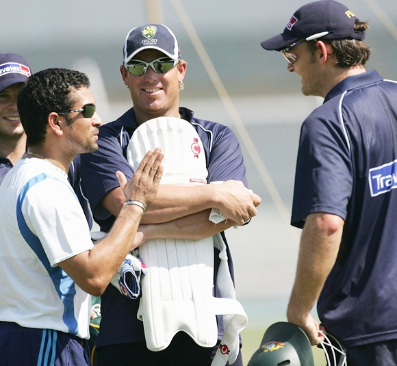 Sachin Tendulkar of India speaks with Brad Hodge, Shane Warne and Adam Gilchrist of Australia