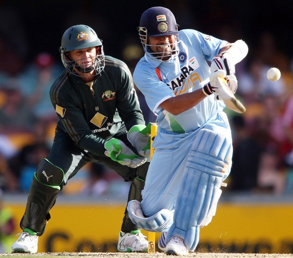 Sachin Tendulkar of India pulls the ball as Adam Gilchrist of Australia keeps wicket