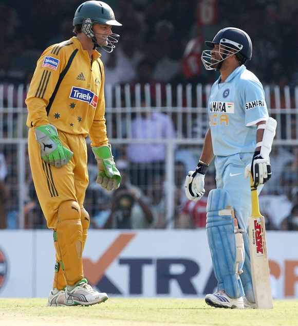 Adam Gilchrist of Australia chats with Sachin Tendulkar of India