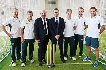 Brad Haddin, David Warner, Darren Lehman, Michael Clarke, Steve Smith, Nathan Lyon and Ryan Harris pose for a photograph after the Australia Test Squad announcement at the National Cricket Centre in Brisbane on Monday