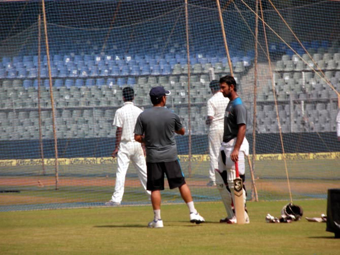 Sachin Tendulkar talks to Cheteshwar Puajara during India's training session at the Wankhede on Wednesday