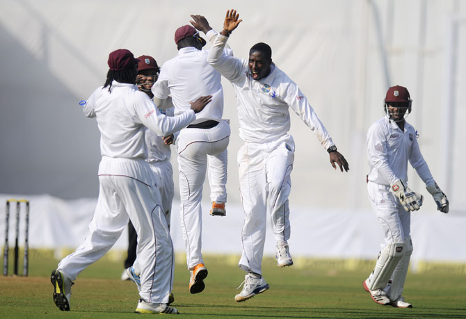 Shane Shillingford of West Indies celebrates the wicket of Murali Vijay