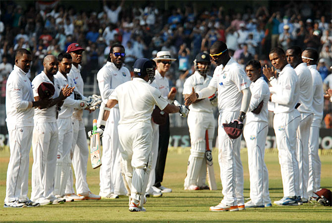 The West Indies players give Sachin Tendulkar a guard of honour as he walks out to bat at the Wankhede stadium in his farewell Test