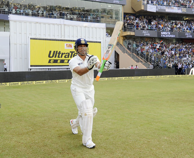 Sachin Tendulkar of India walks to bat