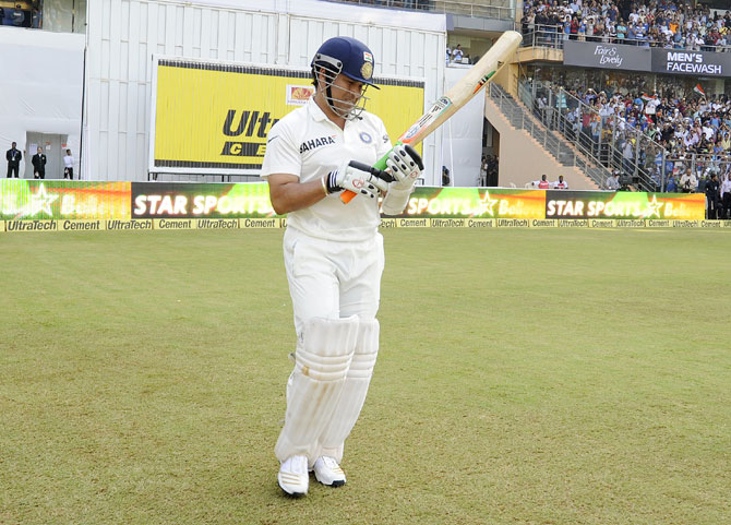 Sachin Tendulkar of India walks to bat during day one