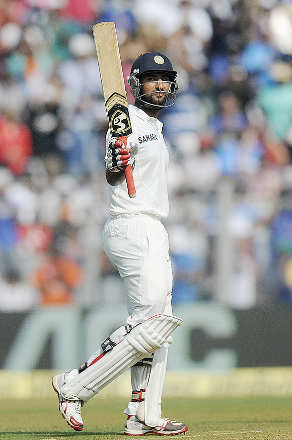 Cheteshwar Pujara celebrates his half-century on Friday