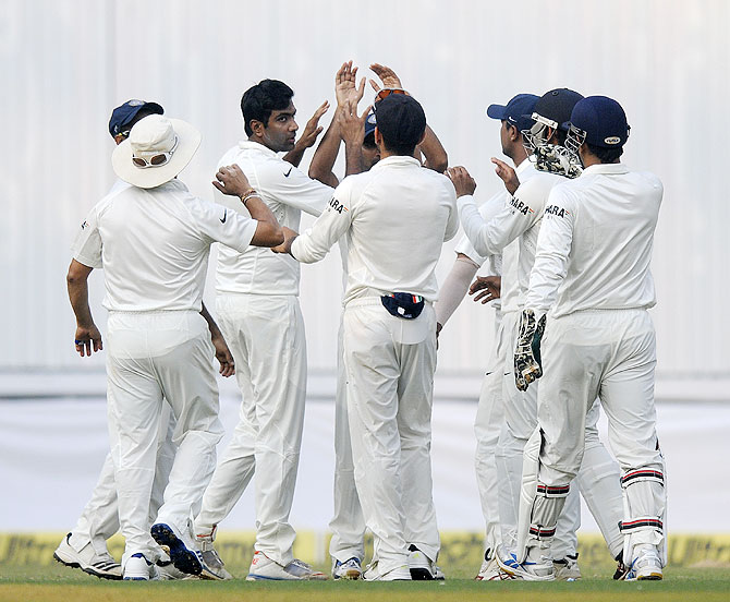 R Ashwin celebrates after dismissing Kieran Powell at the Wankhede on Friday