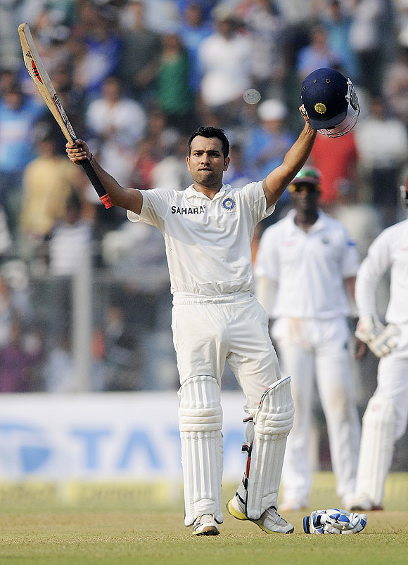 Rohit Sharma celebrates his century at the Wankhede on Friday