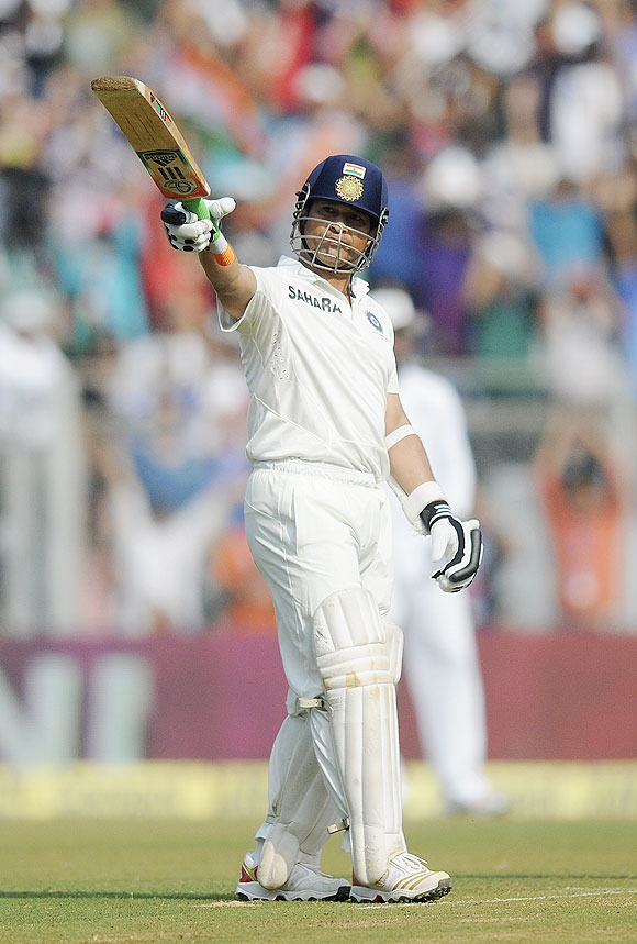 Sachin Tendulkar celebrates his half-century at the Wankhede on Friday