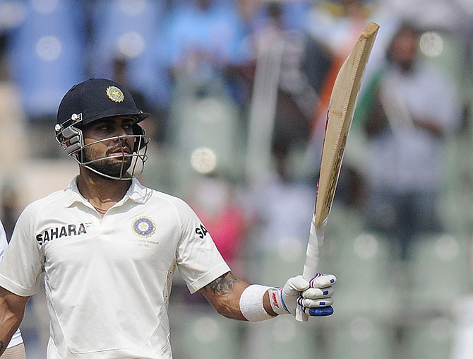 Virat Kohli celebrates his half century on Friday