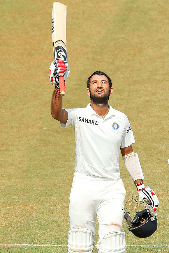 Cheteshwar Pujara celebrates on completing his century on Friday