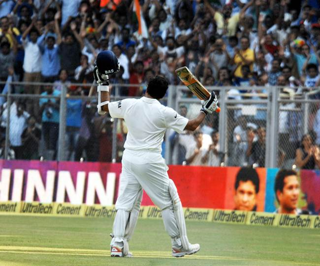 Sachin Tendulkar return to the pavilion after being dismissed for 74