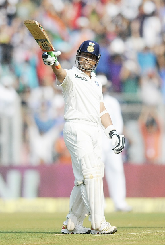 Sachin Tendulkar celebrates his half-century at the Wankhede on Friday morning