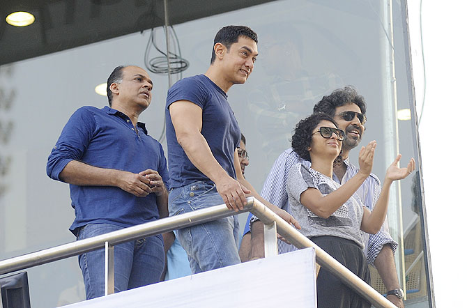 Actor Aamir Khan with wife Kiran Rao and director Ashutosh Gowarikar at the Wankhede on Friday
