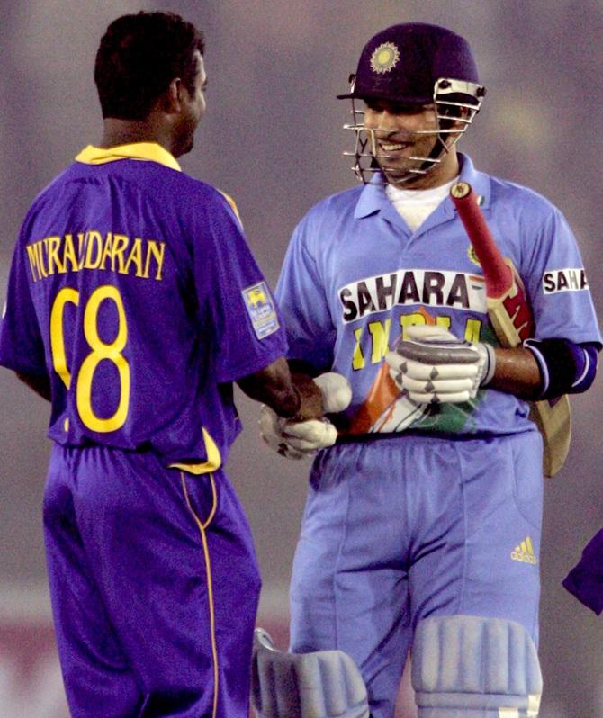 Sri Lanka's Muttiah Muralitharan (left) congratulates India's Sachin Tendulkar