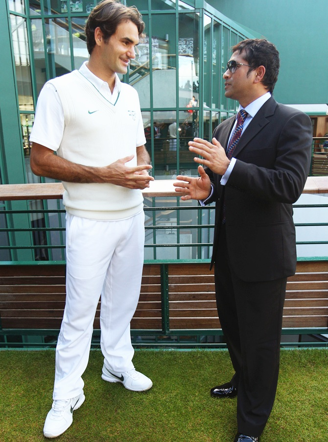Cricket player Sachin Tendulkar (right) speaks with tennis player Roger Federer