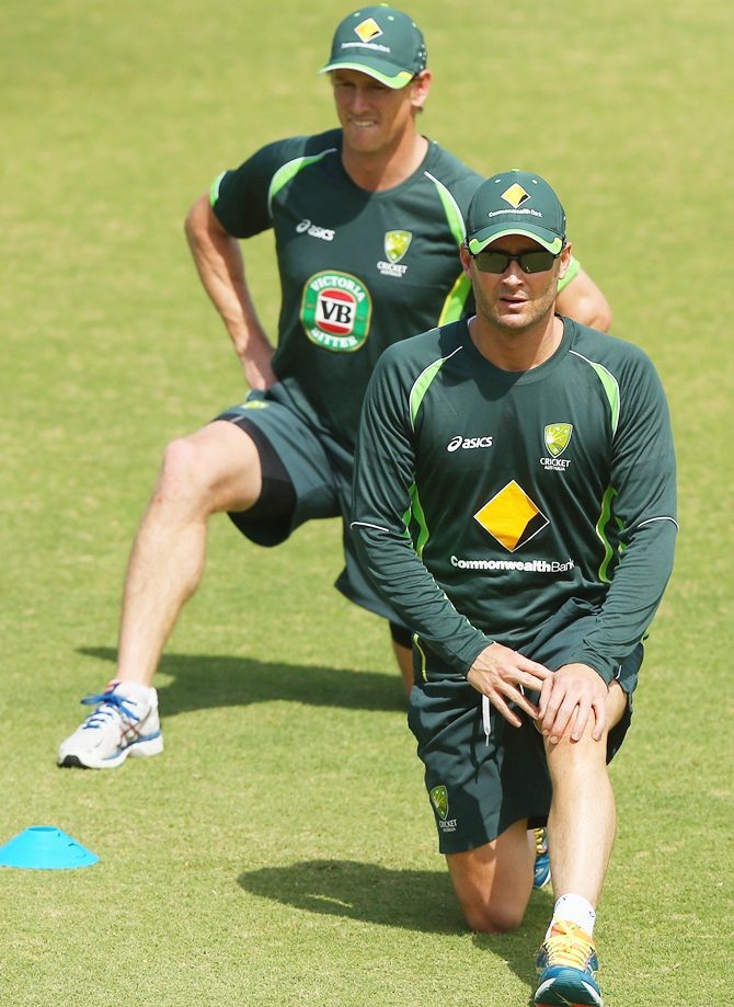 Michael Clarke and George Bailey stretch during an Australian nets session