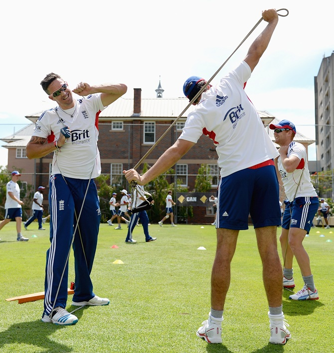 Kevin Pietersen and Alastair Cook of England warm up ahead of an England nets session