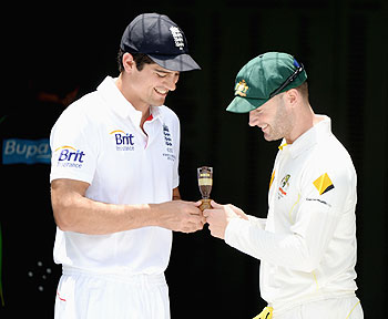 England captain Alastair Cook and Australia captain Michael Clarke hold a replica of the Ashes urn during an Ashes captain's photocall at The Gabba in Brisbane