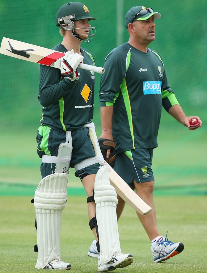 Steve Smith and Coach Darren Lehmann talk during an Australian nets session