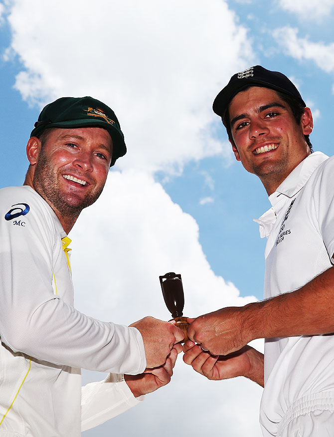 Australia captain Michael Clarke and England captain Alastair Cook hold a replica urn during an Ashes captain's photocall at The Gabba in Brisbane on Wednesday
