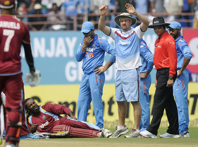 Chris Gayle of West Indies is seen in pain as he gets hurt while trying to make his crease to complete a run in Kochi