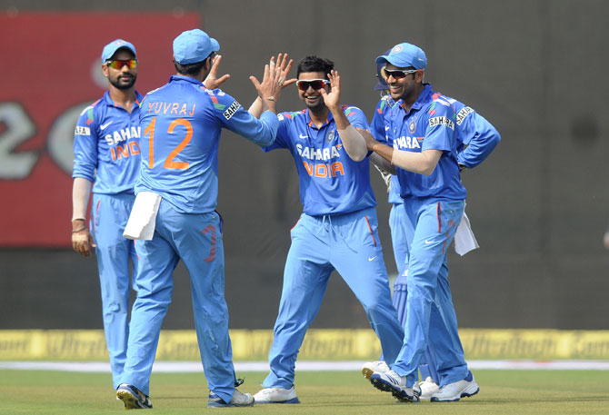 Suresh Raina of India celebrates the wicket of Marlon Samuels of West Indies