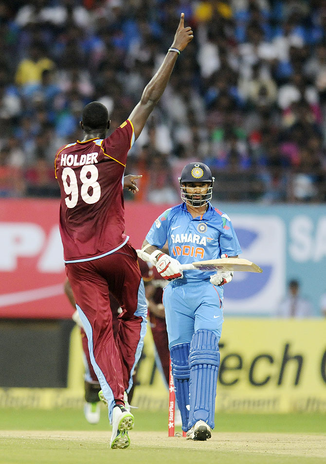 Jason Holder celebrates the wicket of Shikhar Dhawan