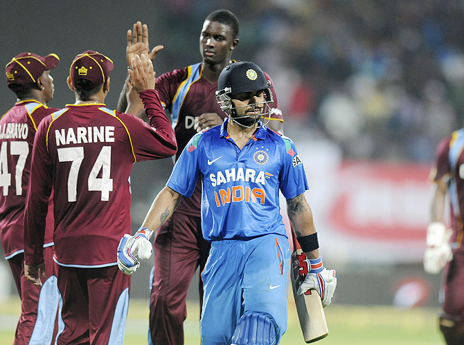 Jason Holder celebrates the wicket of Virat Kholi