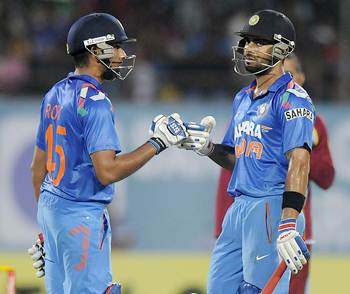 Rohit Sharma (left) and Virat Kohli compliment each other during the course of their innings