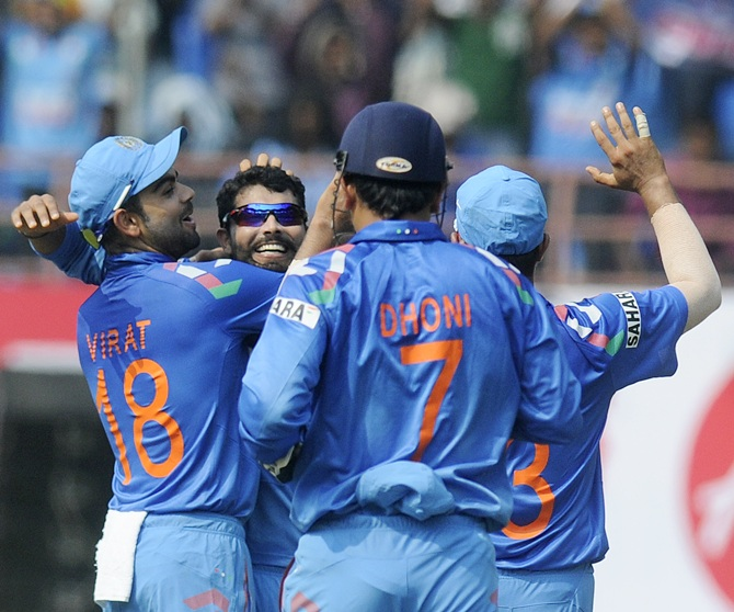 Ravindra Jadeja of India celebrates with teammates