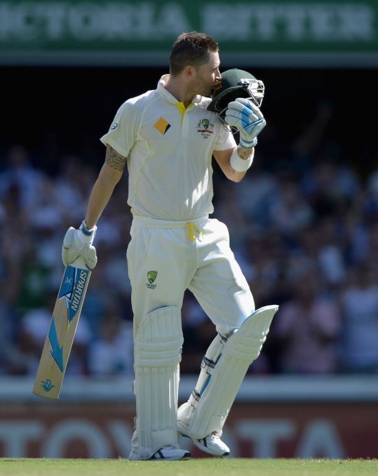 Michael Clarke reacts after reaching his century