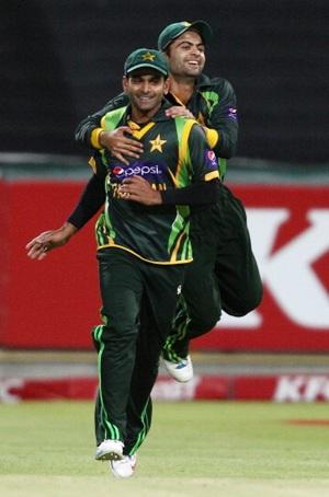 Pakistan captain Mohammad Hafeez and Ahmed Shehzad celebrate victory