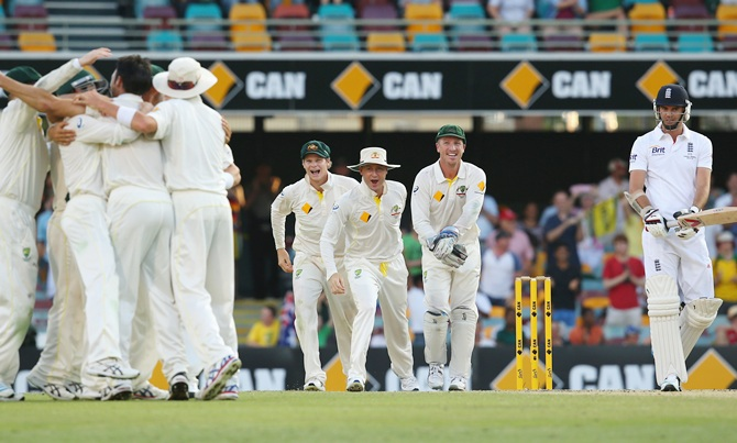 Steve Smith, Michael Clarke and Brad Haddin of Australia celebrate victory after Mitchell   Johnson of Australia took the wicket of James Anderson
