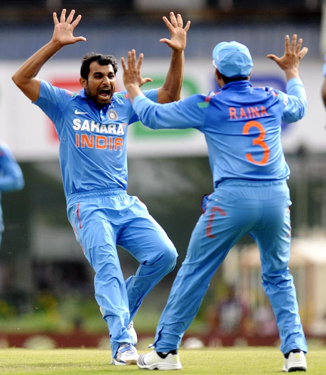 Mohammed Shami (left) celebrates with Suresh Raina