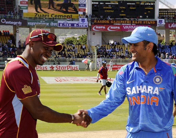 West Indies captain Dwayne Bravo (left) with India's captain Mahendra Singh Dhoni