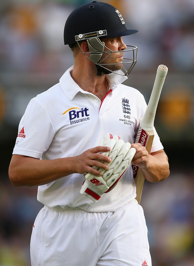 Jonathan Trott of England walks off the field