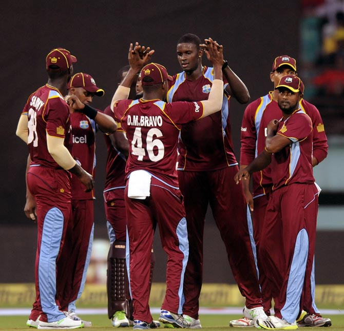 West Indies team celebrate the fall on an Indian wicket